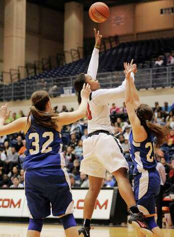 Wagner's Tesha Smith (center) shoots over Del Rio's Kelsey Green (right) and Leah Fisher during the second half of their playoff game on Friday, Feb. 24, 2012, at UTSA. Wagner won 58-46. Photo: Darren Abate, For The Express-News