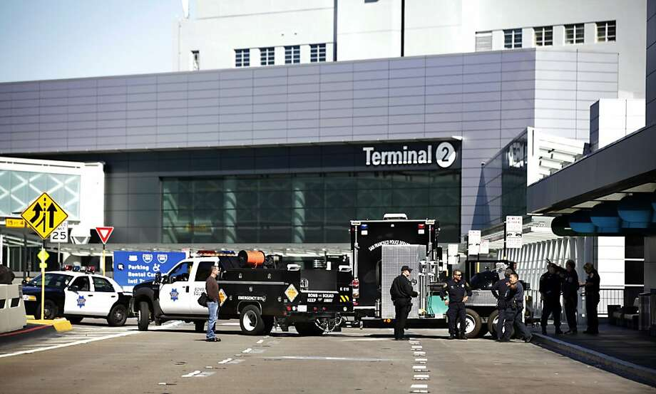The San Francisco Police Department Bomb Squad and other vehicles are seen at SFO after they were called in to investigate a suspicious device that had been spotted in a bag at a security checkpoint in Terminal 1 at Boarding Area C on Friday, February 24, 2012 at San Francisco International Airport in San Francisco, Calif.  The area was reopened shortly before 1:30 p.m. after the device was found to be harmless. Photo: Lea Suzuki, The Chronicle