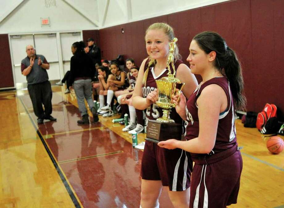 Wooster's Monica Dahlgren, left, and Anna Fisher hold the Hudson Valley Athletic League championship trophy after beating Oakwood Friends School 55-29 at Wooster School in Danbury on Saturday, Feb. 25, 2012. Wooster finished their season undefeated. Photo: Jason Rearick / The News-Times