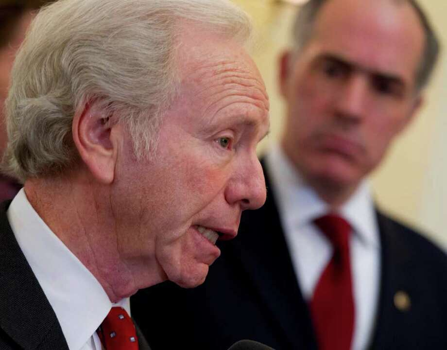 Sen. Joseph I. Lieberman, I-Conn., accompanied by Sen. Bob Casey, D-Pa., speaks during a bi-partisan news conference on Capitol Hill in Washington, Thursday, Feb. 16, 2012, to support President Obama's sanctions against Iran for pursuing nuclear weapons. (AP Photo/J. Scott Applewhite) Photo: J. Scott Applewhite, Associated Press / AP