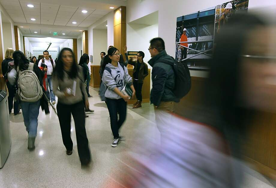 Law school students and faculty move through a hallway of the newly-completed wing at the UC Berkeley School of Law on Tuesday, Feb. 21, 2012, which is celebrating its centennial this year. Photo: Paul Chinn, The Chronicle