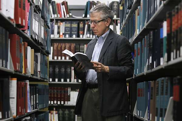 Environmental law professor Daniel Farber browses through the library of the UC Berkeley School of Law on Tuesday, Feb. 21, 2012, which is celebrating its centennial this year.