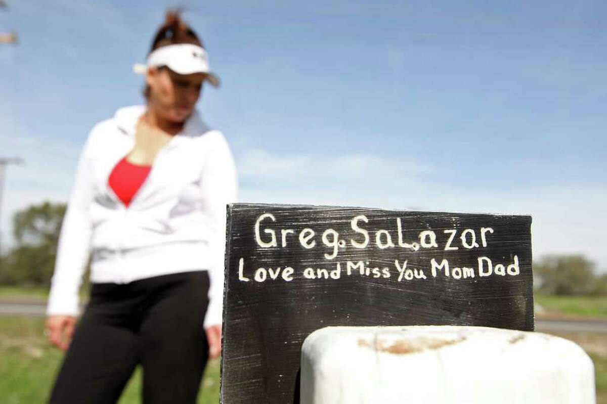 Salazar stands by a homemade memorial for her husband, killed by a drunken driver four years ago.