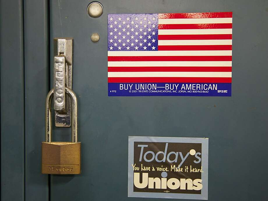 Pro-union stickers adorn a worker's locker at Master Lock company in Milwaukee, Wednesday, Jan, 25, 2012. President Obama highlighted Master Lock in his State of the Union address Tuesday night for moving jobs back to the U.S. from China. The padlock and security products manufacturer has returned about 100 union jobs to its Milwaukee factory since mid-2010, and would like to bring more jobs back from overseas if economic conditions support the move. (AP Photo/Jeffrey Phelps) Photo: Jeffrey Phelps, Associated Press
