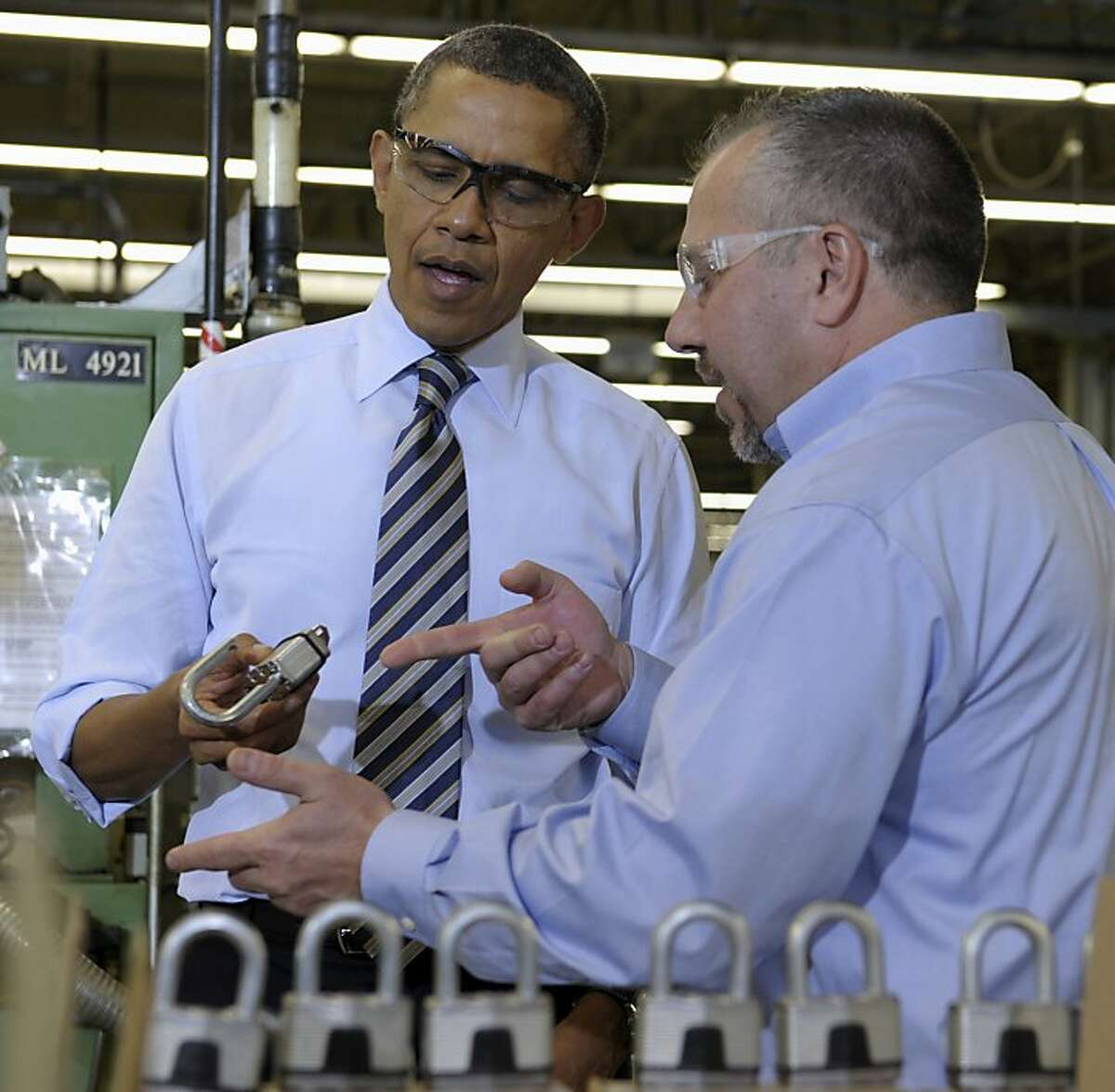President Barack Obama holds a lock as he tours Master Lock in Milwaukee, Wednesday, Feb. 15, 2012, with Senior Vice President Bon Rice. Obama is visiting the Master Lock manufacturing operation before heading on a three-day trip to the West Coast. (AP Photo/Susan Walsh)