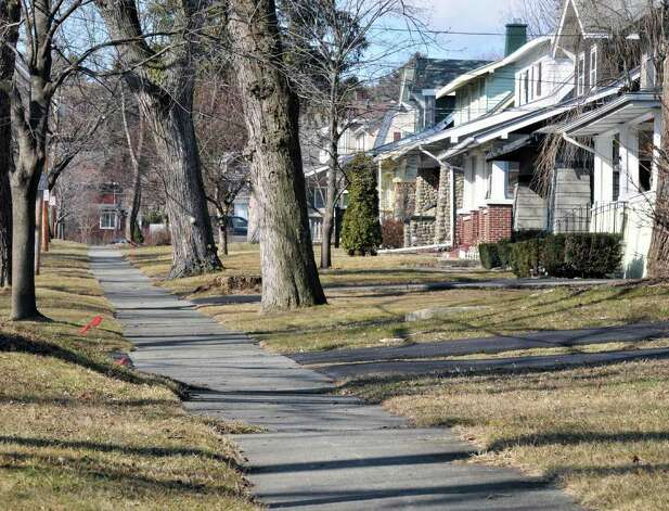 Sidewalk and homes along Tillinghast Avenue in Menands Friday Feb. 17, 2012.   (John Carl D'Annibale / Times Union) Photo: John Carl D'Annibale