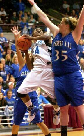 Ozen's Bealoved Brown goes up for a basket as Barbers Hill's Kendall Shaw defends at the Aldine Campbell Center in Houston, Saturday, February 25, 2012. Tammy McKinley/The Enterprise Photo: TAMMY MCKINLEY