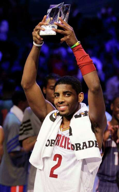 Cleveland Cavaliers' Kyrie Irving, of Team Chuck, hold the MVP trophy following the NBA All-Star Rising Stars Challenge game in Orlando, Fla. Friday, Feb. 24, 2012. Team Chuck defeated Team Shaq 146-133. Photo: AP