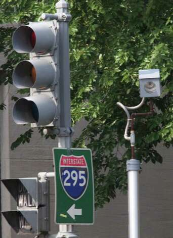 A camera is placed near a traffic light for drivers who run red lights on Constitution Avenue August 31, 2001 in Washington, DC. Connecticut legislators are considering enabling municipalities to use the cameras, but there is conflicting evidence on whether they actually improve safety. (Photo by Mark Wilson/Getty Images) Photo: Mark Wilson, Getty Images / Getty Images North America