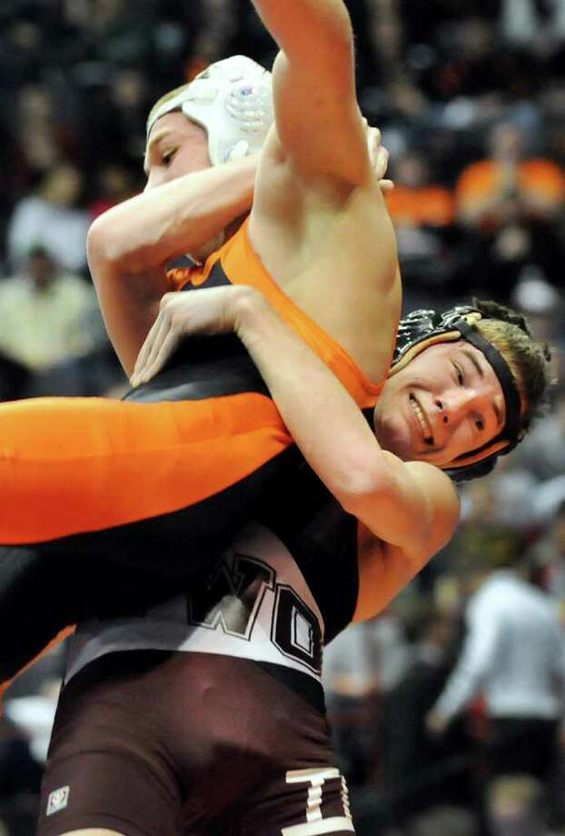 Corinth's Zach Marcel, right, lifts Fredonia's Dakota Gardner in their 120-pound consolation match during the State Wrestling Tournament on Saturday, Feb. 25, 2012, at Times Union Center in Albany, N.Y. Gardner wins. (Cindy Schultz / Times Union) Photo: Cindy Schultz / 00016194A