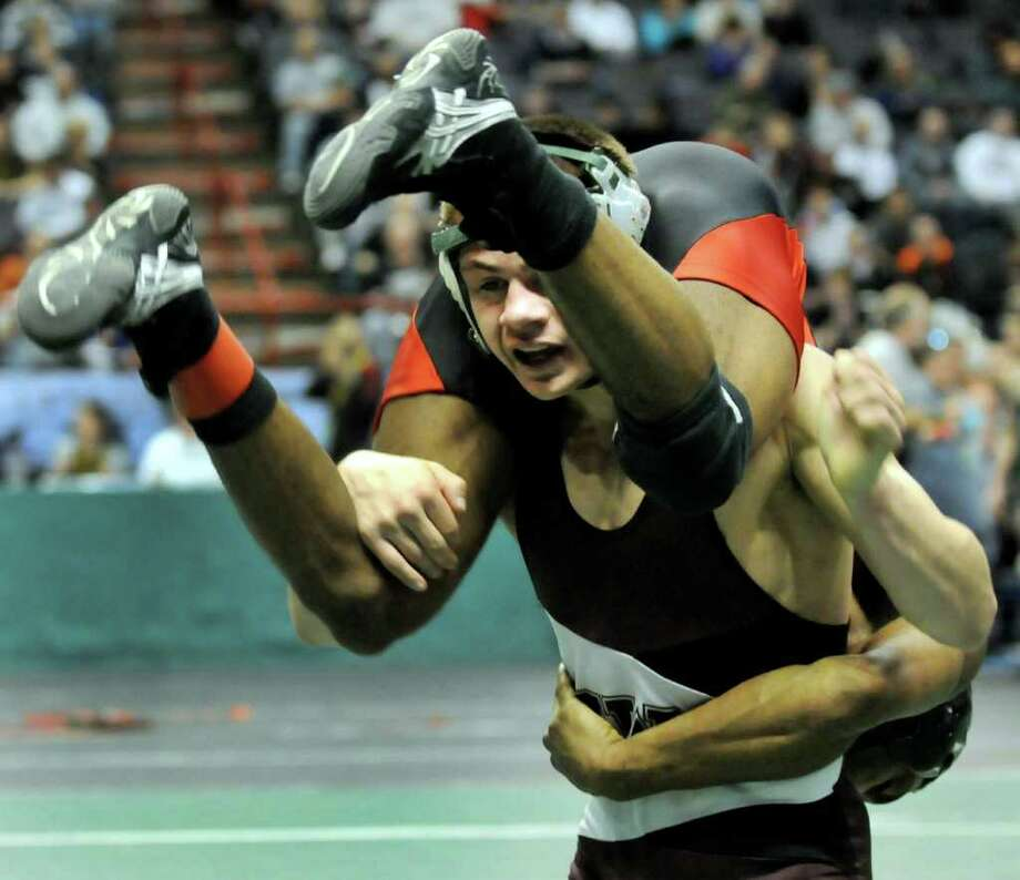 Shenendehowa's Nick Kelley, bottom, lifts St. Anthony's Jamel Hudson in their Division I 132-pound semi-final match during the State Wrestling Tournament on Saturday, Feb. 25, 2012, at Times Union Center in Albany, N.Y. Hudson wins. (Cindy Schultz / Times Union) Photo: Cindy Schultz / 00016194A