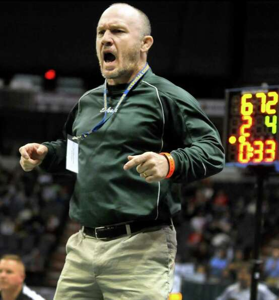 Shenendehowa's coach Rob Weeks jumps in excitement as Nick Kelley grapples St. Anthony's Jamel Hudso