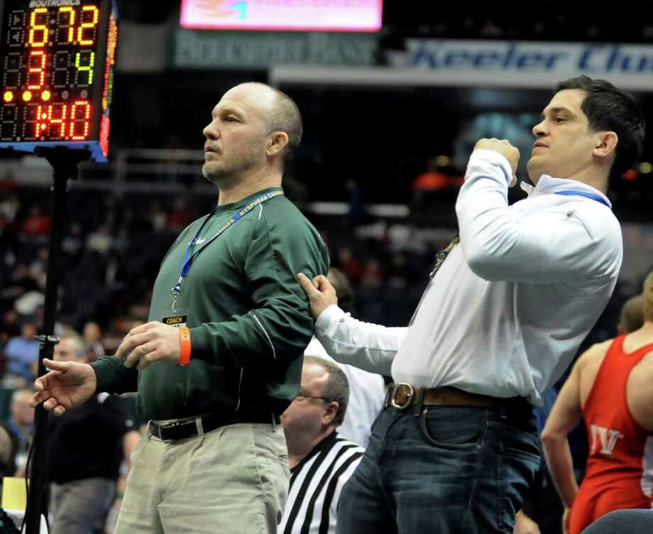 Shenendehowa's coach Rob Weeks, left, and assistant coach Frank Popolizio react as Nick Kelley grapples St. Anthony's Jamel Hudson in their Division I 132-pound semi-final match during the State Wrestling Tournament on Saturday, Feb. 25, 2012, at Times Union Center in Albany, N.Y. Hudson wins. (Cindy Schultz / Times Union) Photo: Cindy Schultz / 00016194A