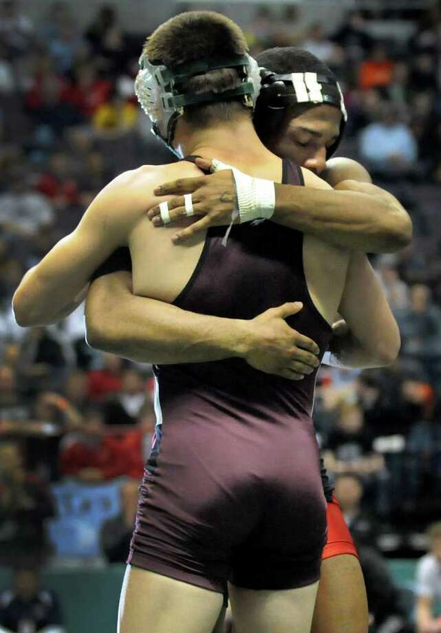 St. Anthony's Jamel Hudson embraces Shenendehowa's Nick Kelley after their Division I 132-pound semi-final match during the State Wrestling Tournament on Saturday, Feb. 25, 2012, at Times Union Center in Albany, N.Y. Hudson wins. (Cindy Schultz / Times Union) Photo: Cindy Schultz / 00016194A