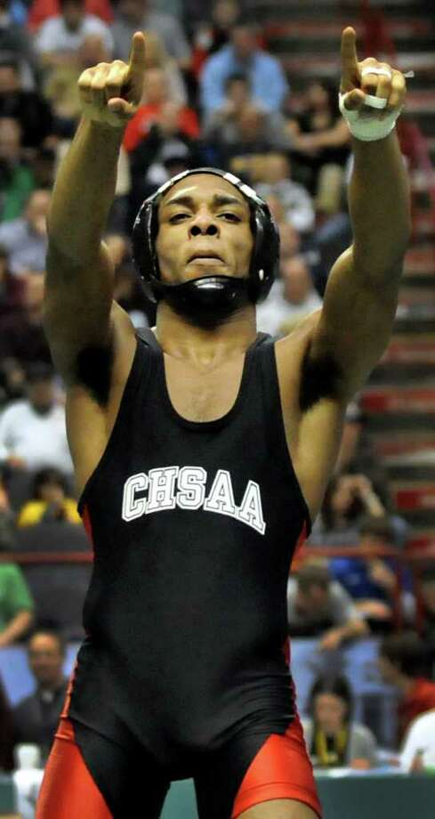 St. Anthony's Jamel Hudson celebrates his win over Shenendehowa's Nick Kelley in their Division I 132-pound semi-final match during the State Wrestling Tournament on Saturday, Feb. 25, 2012, at Times Union Center in Albany, N.Y. (Cindy Schultz / Times Union) Photo: Cindy Schultz / 00016194A