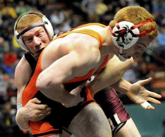 Columbia's Evan Wallace, left, grapples Iroquois' James Kloc in their Division I 145-pound semi-final match during the State Wrestling Tournament on Saturday, Feb. 25, 2012, at Times Union Center in Albany, N.Y. Kloc wins. (Cindy Schultz / Times Union) Photo: Cindy Schultz / 00016194A