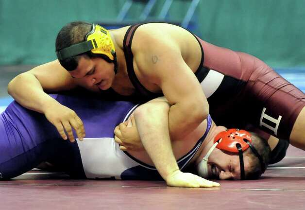 Ravena's Alex Soutiere, top, grapples Holley's Kacee Sauer in their Division II 285-pound semi-final match during the State Wrestling Tournament on Saturday, Feb. 25, 2012, at Times Union Center in Albany, N.Y. Soutiere wins the match to upset top-seeded Sauer. (Cindy Schultz / Times Union) Photo: Cindy Schultz / 00016194A
