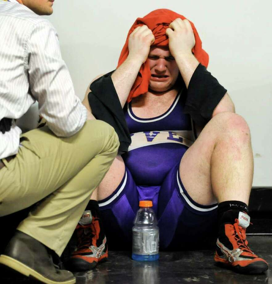 Holley's Kacee Sauer is inconsolable after losing to Ravena's Alex Soutiere in their Division II 285-pound semi-final match during the State Wrestling Tournament on Saturday, Feb. 25, 2012, at Times Union Center in Albany, N.Y. (Cindy Schultz / Times Union) Photo: Cindy Schultz / 00016194A