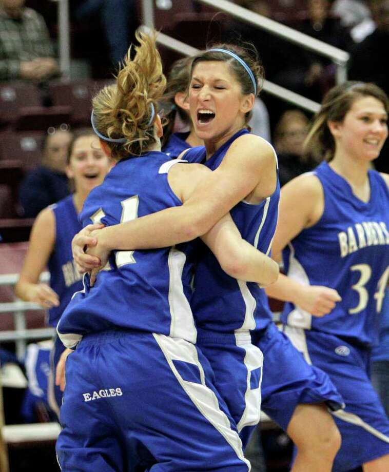 Barbers Hill's Kimberlin Naivar #14, right, and Shannon Evans #11 celebrate after defeating Beaumont Ozen during the Region III 4A girls basketball finals between Barbers Hill and Beaumont Ozen at the M.O. Campbell Center Feb.  25, 2012 in Houston, Tx. Photo: Bob Levey, Houston Chronicle / ©2012 Bob Levey
