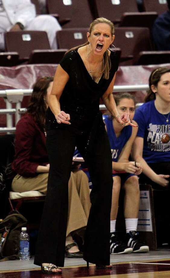 Barbers Hill's head coach Kit Martin encourages her team during the Region III 4A girls basketball finals between Barbers Hill and Beaumont Ozen at the M.O. Campbell Center Feb.  25, 2012 in Houston, Tx. Photo: Bob Levey, Houston Chronicle / ©2012 Bob Levey