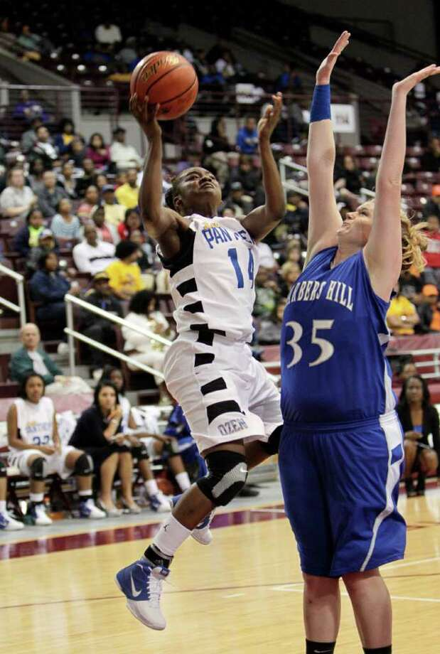 Beaumont Ozen's Bealoved Brown #14 drives past Barbers Hill's Kendall Shaw #35 during the Region III 4A girls basketball finals between Barbers Hill and Beaumont Ozen at the M.O. Campbell Center Feb.  25, 2012 in Houston, Tx. Photo: Bob Levey, Houston Chronicle / ©2012 Bob Levey