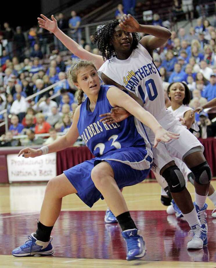 Barbers Hill's Kaylee Kana #23 and Beaumont Ozen's Sanquiesha Rawls #10 battle for position under the basket during the Region III 4A girls basketball finals between Barbers Hill and Beaumont Ozen at the M.O. Campbell Center Feb.  25, 2012 in Houston, Tx. Photo: Bob Levey, Houston Chronicle / ©2012 Bob Levey
