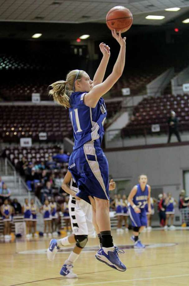 Barbers Hill's Shannon Evans #11 puts up a jumper during the Region III 4A girls basketball finals between Barbers Hill and Beaumont Ozen at the M.O. Campbell Center Feb.  25, 2012 in Houston, Tx. Photo: Bob Levey, Houston Chronicle / ©2012 Bob Levey