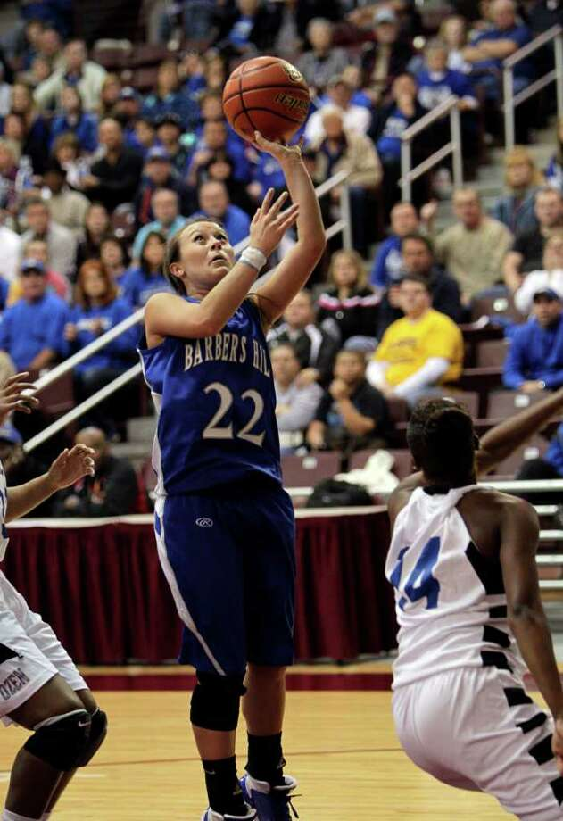 Barbers Hill's Makenzi May #22 puts up a short jumper in the paint during the Region III 4A girls basketball finals between Barbers Hill and Beaumont Ozen at the M.O. Campbell Center Feb.  25, 2012 in Houston, Tx. Photo: Bob Levey, Houston Chronicle / ©2012 Bob Levey