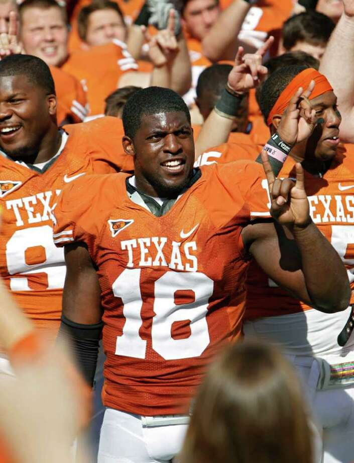 Texas linebacker Emmanuel Acho believes he can make a splash in the NFL as a rookie just like his big brother, Sam Acho. Photo: Erich Schlegel, Getty Images / 2011 Getty Images