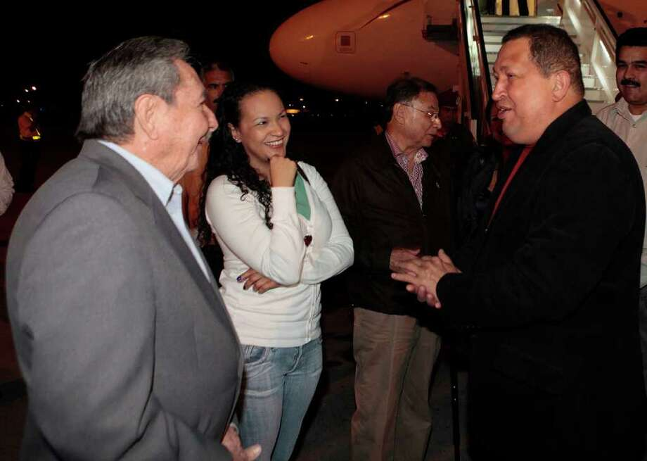 In this photo released by Miraflores Press Office, Venezuela's President Hugo Chavez, right, accompanied by one of his daughters, Rosa, second from left, is welcomed by Cuba's President Raul Castro, left, upon his arrival to Havana, Cuba, Friday, Feb. 24, 2012. Chavez is in Cuba for urgent surgery to remove a tumor he says is probably malignant. Photo: AP