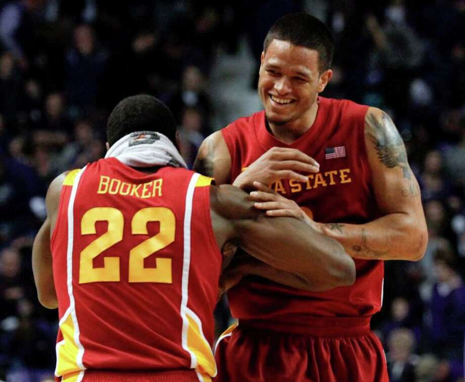 Iowa State's Anthony Booker (22) and Chris Babb celebrate a 65-61 win over Kansas State after an NCAA college basketball game Saturday, Feb. 25, 2012, in Manhattan, Kan. Photo: AP