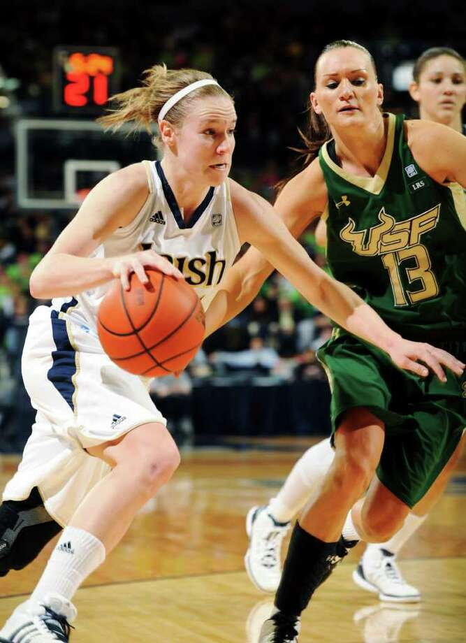 Notre Dame guard Natalie Novosel (left) drives past South Florida's Inga Orekhova during her 32-point performance. Photo: Joe Raymond, Associated Press