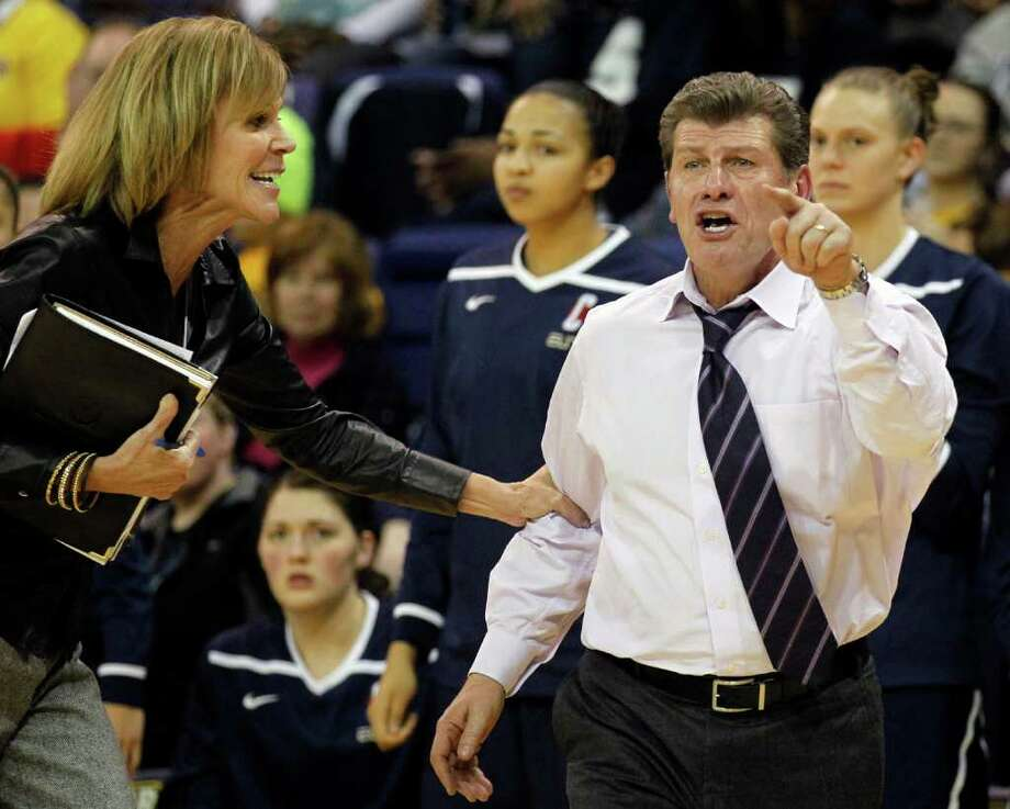 Connecticut associate head coach Chris Dailey, left, grabs head coach Geno Auriemma as he reacts in the second half of an NCAA college basketball game against Marquette on Saturday, Feb. 25, 2012, in Milwaukee. (AP Photo/Jeffrey Phelps) Photo: Jeffrey Phelps/Associated Press / FR59249 AP
