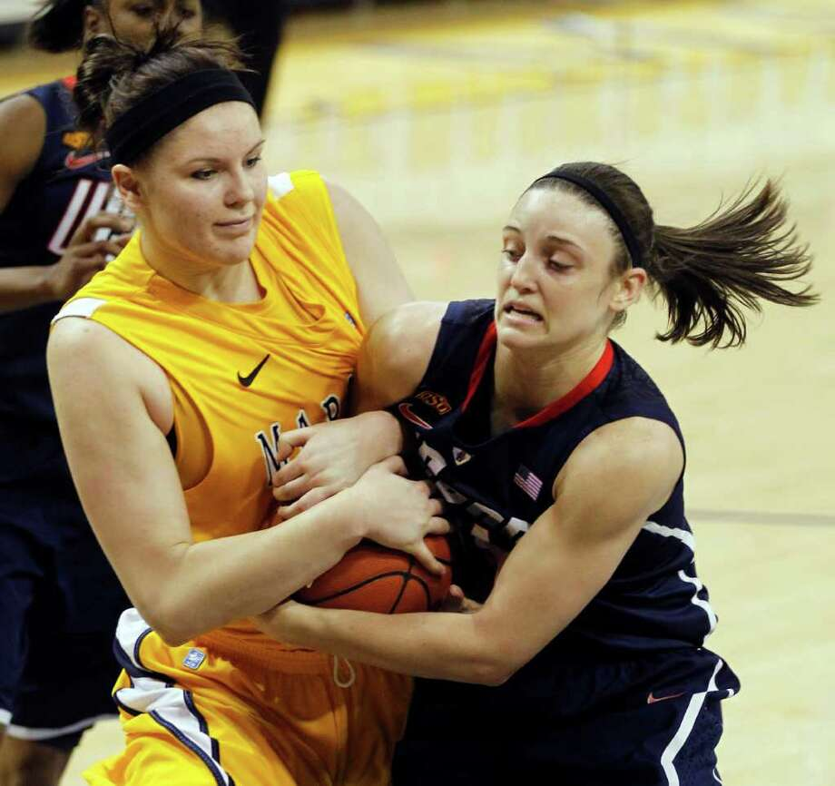Marquette's Chelsie Butler, left, and Connecticut's Kelly Faris wrestle for a rebound in the first half of an NCAA college basketball game, Saturday, Feb. 25, 2012, in Milwaukee. (AP Photo/Jeffrey Phelps) Photo: JEFFREY PHELPS, Jeffrey Phelps/Associated Press / FR59249 AP