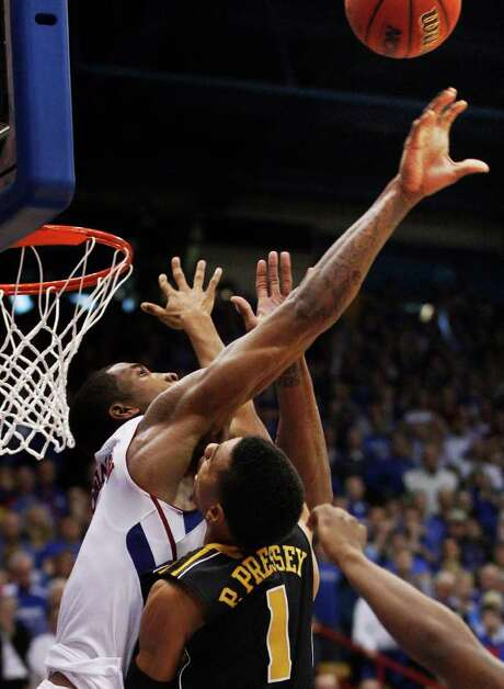 Kansas forward Thomas Robinson, left, blocks a shot by Missouri guard Phil Pressey (1) at the end of regulation time during an NCAA college basketball game in Lawrence, Kan., Saturday, Feb. 25, 2012. The blocked shot sent the game into overtime. Kansas defeated Missouri 87-86 in overtime. Photo: AP