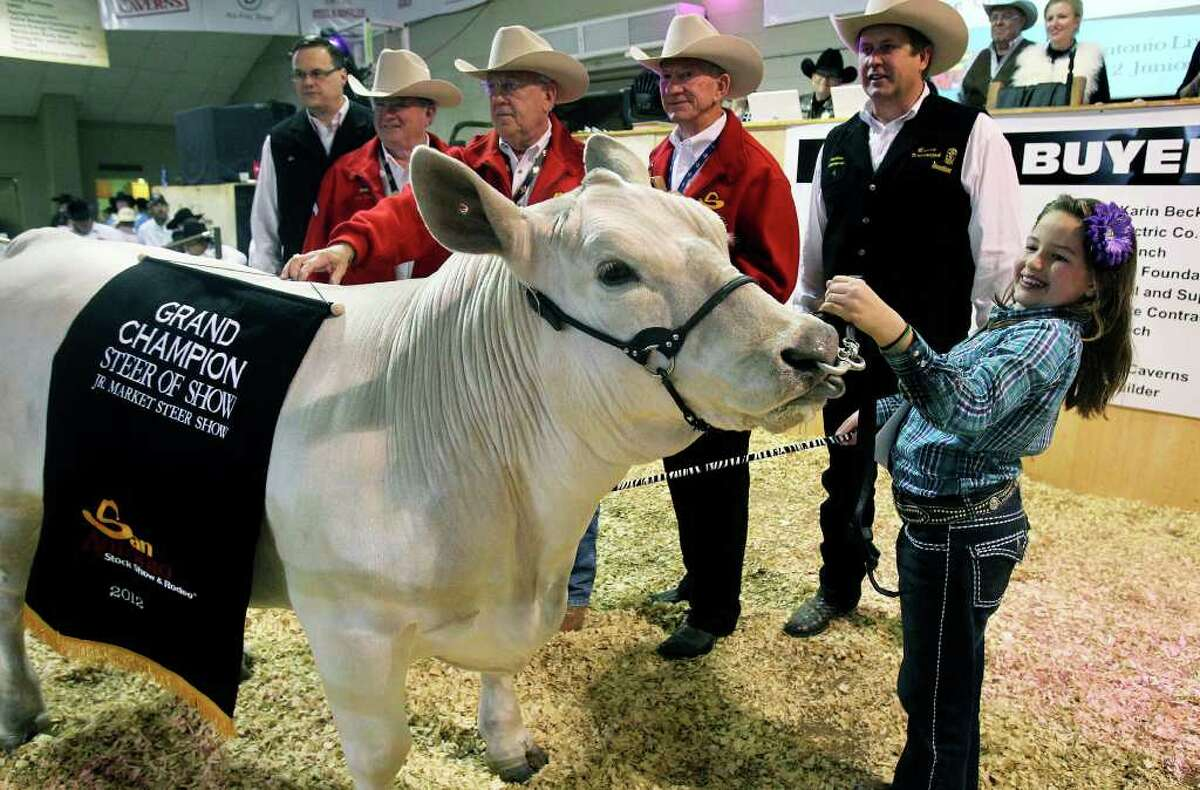 METRO Caeley Jane Cody sells her junior grand champion steer at auction for $112,000 at the San Antonio Livestock Show & Rodeo on February 25, 2012 Tom Reel/ San Antonio Express-News
