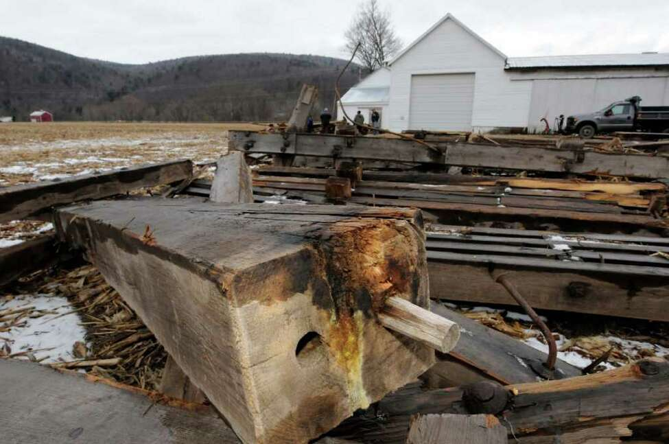 Pieces rescued of the historic Blenheim covered bridge in Blenheim, N.Y. Friday Feb.24, 2012. ( Michael P. Farrell/Times Union)