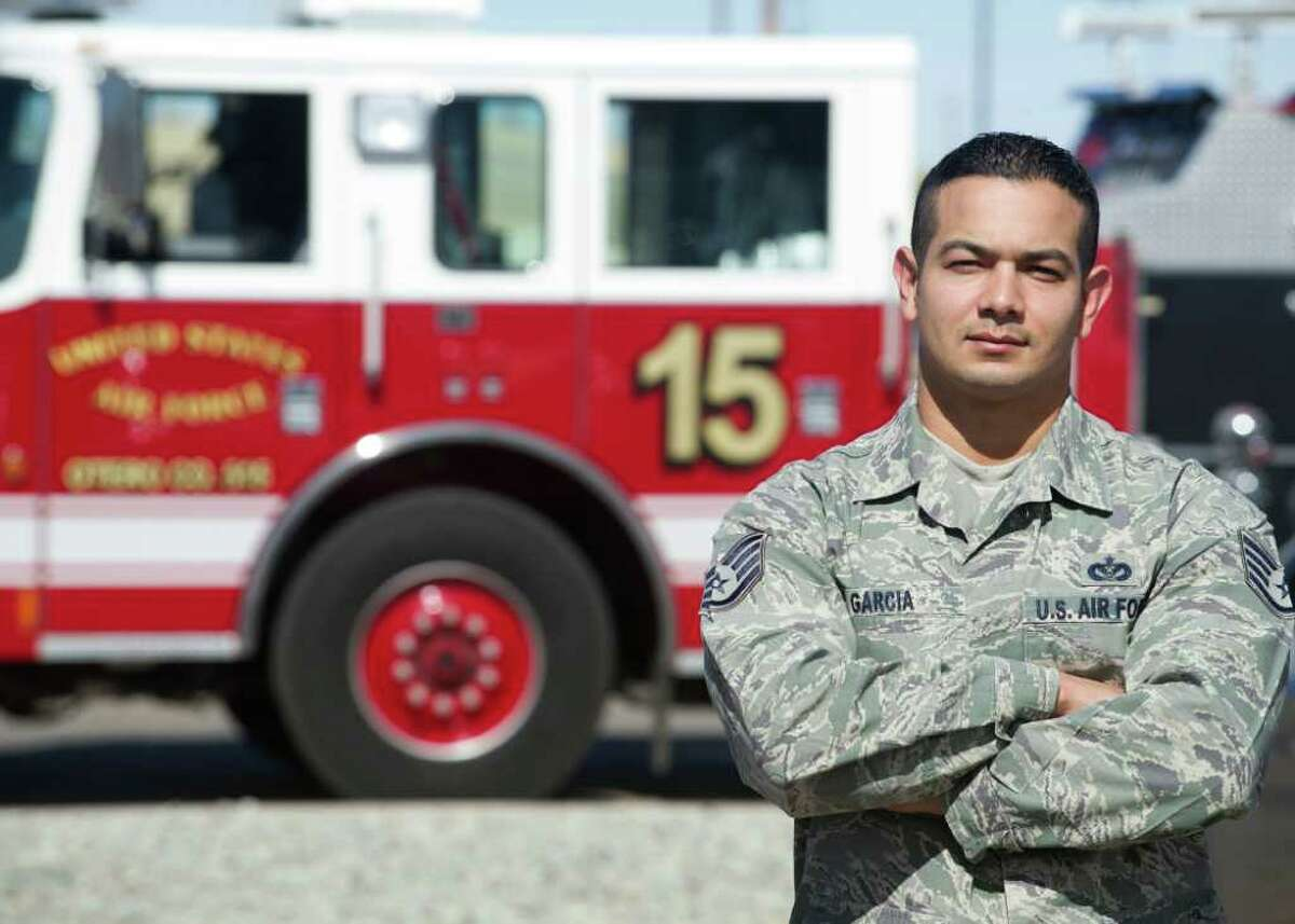 Staff Sgt. Lionel Garcia, a 49th Civil Engineer Squadron firefighter, poses for a photo, Feb. 23, at Holloman Air Force Base, N.M. While on leave in San Antonio, Garcia saved the life of a police officer who was struck by a passing motorist, Feb. 19. The officer is expected to make a full recovery. Garcia credits his actions to all of the Air Force fire protection training he has received.