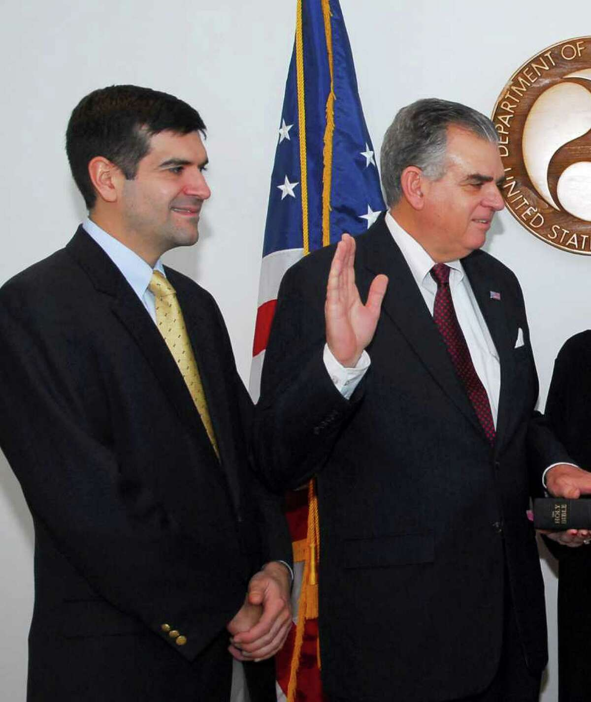 FILE - In this Jan. 23, 2009 handout file photo proved by the Transportation Department, Sam Lahood, left, watches as his father Ray is sworn in as Transportation Secretary, at the Transportation Department in Washington. Egypt released names of the 19 Americans employees of nonprofit organizations referred to trial over accusations of illegally receiving foreign funds in a case that deepened crisis between Egypt and the United States. The Americans listed in the prosecutor's records work for four U.S.-funded groups promoting democracy and human rights including Freedom House and the International Republican Institute whose director is Sam LaHood, the son of U.S. Transportation Secretary Ray LaHood.