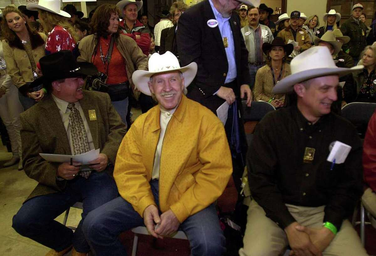 Champion Ranch owner Richard Wallrath is all smiles after making the winning bid of $87,500 for the grand champion steer at the junior live stoch auction on Saturday, February 17, 2001.