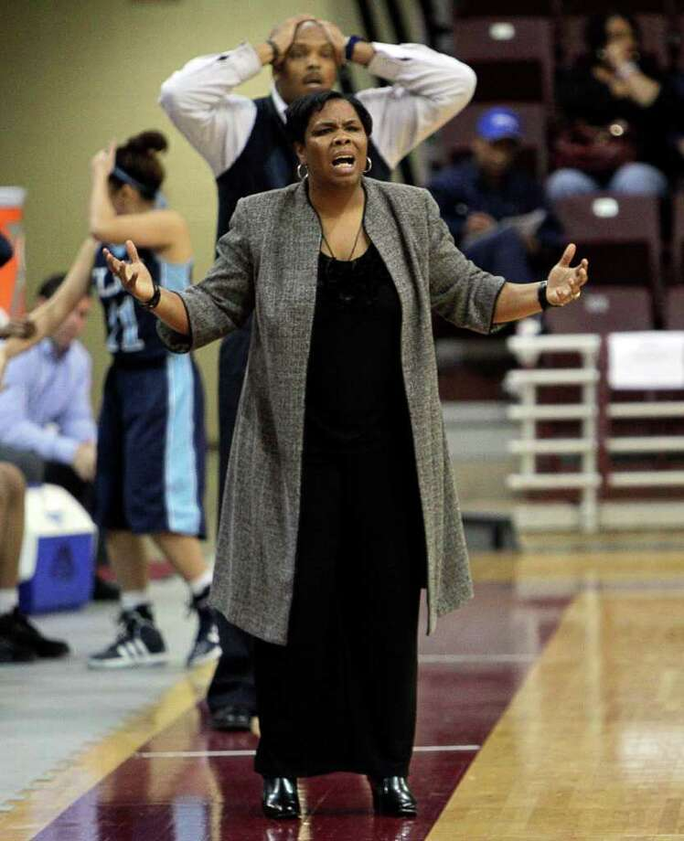 Elsik head coach LaShawn Johnson questions an officials call during the Region III 5A girls basketball finals between Cy Falls and Alief Elsik at the M.O. Campbell Center Feb.  25, 2012 in Houston, Tx. Photo: Bob Levey, Houston Chronicle / ©2012 Bob Levey