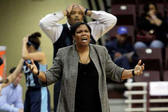 Elsik head coach LaShawn Johnson questions an officials call during the Region III 5A girls basketball finals between Cy Falls and Alief Elsik at the M.O. Campbell Center Feb.  25, 2012 in Houston, Tx.