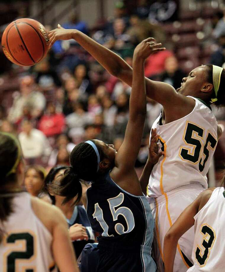 Elsik's Lillian Taylor #15 has her shot blocked by Cy Falls' Carol  Willie #55 during the Region III 5A girls basketball finals between Cy Falls and Alief Elsik at the M.O. Campbell Center Feb.  25, 2012 in Houston, Tx. Photo: Bob Levey, Houston Chronicle / ©2012 Bob Levey