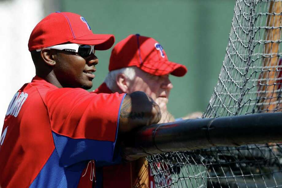 Philadelphia Phillies' Ryan Howard, left, and manager Charlie Manuel watch batting practice during practice at baseball spring training, Friday, Feb. 24, 2012, in Clearwater, Fla. Photo: AP