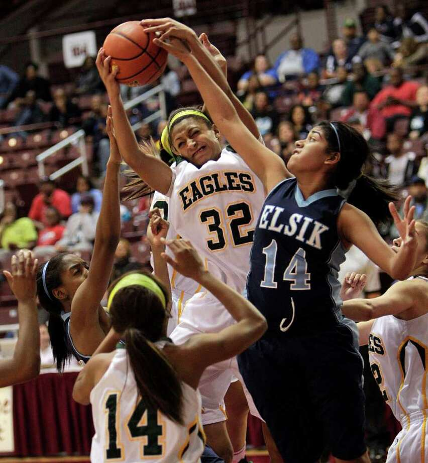 Cy Falls' Loryn Godwin #32 grabs a rebound from Elsik's Gabby Ocanas #14 during the Region III 5A girls basketball finals between Cy Falls and Alief Elsik at the M.O. Campbell Center Feb.  25, 2012 in Houston, Tx. Photo: Bob Levey, Houston Chronicle / ©2012 Bob Levey