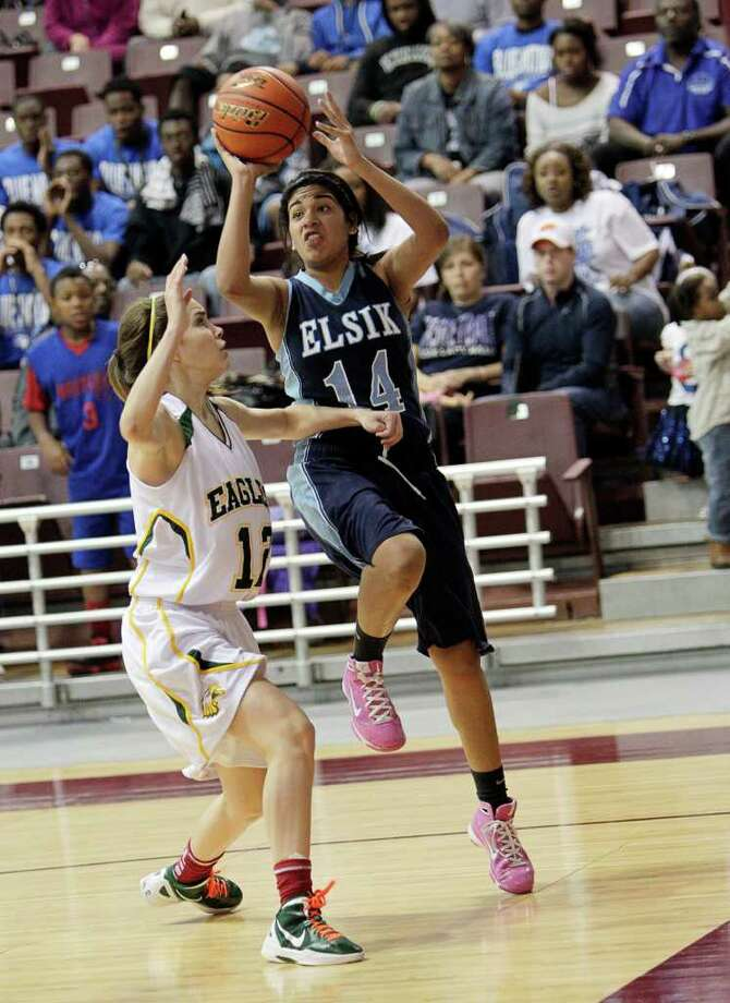 Elsik's Gabby Ocanas #14 drives baseline on Cy Falls' Kit Metoyer #12 during the Region III 5A girls basketball finals between Cy Falls and Alief Elsik at the M.O. Campbell Center Feb.  25, 2012 in Houston, Tx. Photo: Bob Levey, Houston Chronicle / ©2012 Bob Levey