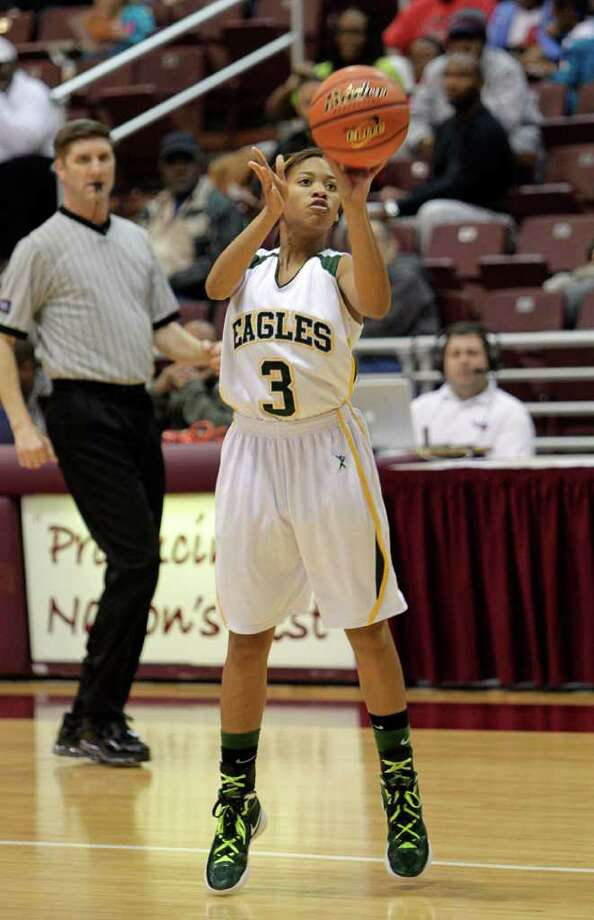Cy Falls' Sadalia Ellis #3 launches a three point attempt during the Region III 5A girls basketball finals between Cy Falls and Alief Elsik at the M.O. Campbell Center Feb.  25, 2012 in Houston, Tx. Photo: Bob Levey, Houston Chronicle / ©2012 Bob Levey