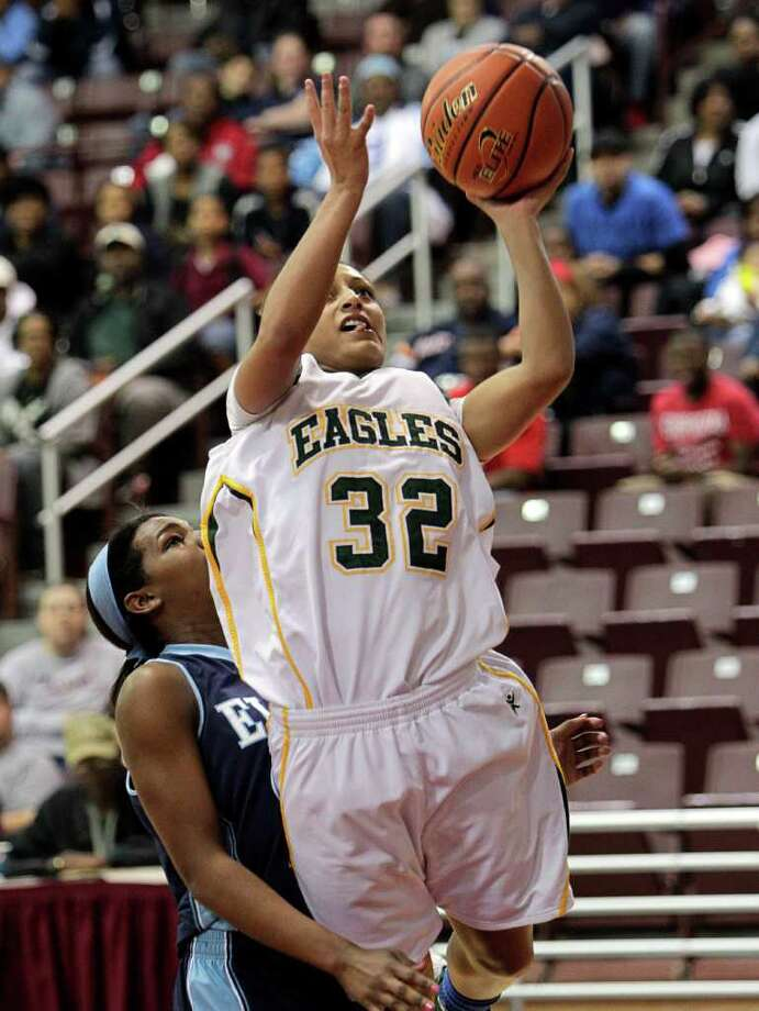 Cy Falls' Loryn Goodwin #32 drives to the basket for a layup during the Region III 5A girls basketball finals between Cy Falls and Alief Elsik at the M.O. Campbell Center Feb.  25, 2012 in Houston, Tx. Photo: Bob Levey, Houston Chronicle / ©2012 Bob Levey