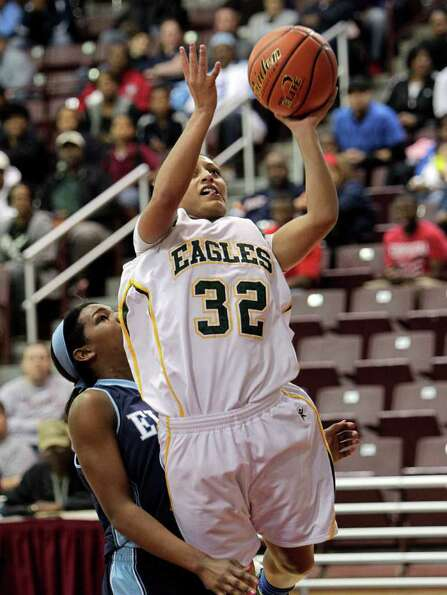 Cy Falls' Loryn Goodwin #32 drives to the basket for a layup during the Region III 5A girls basketba
