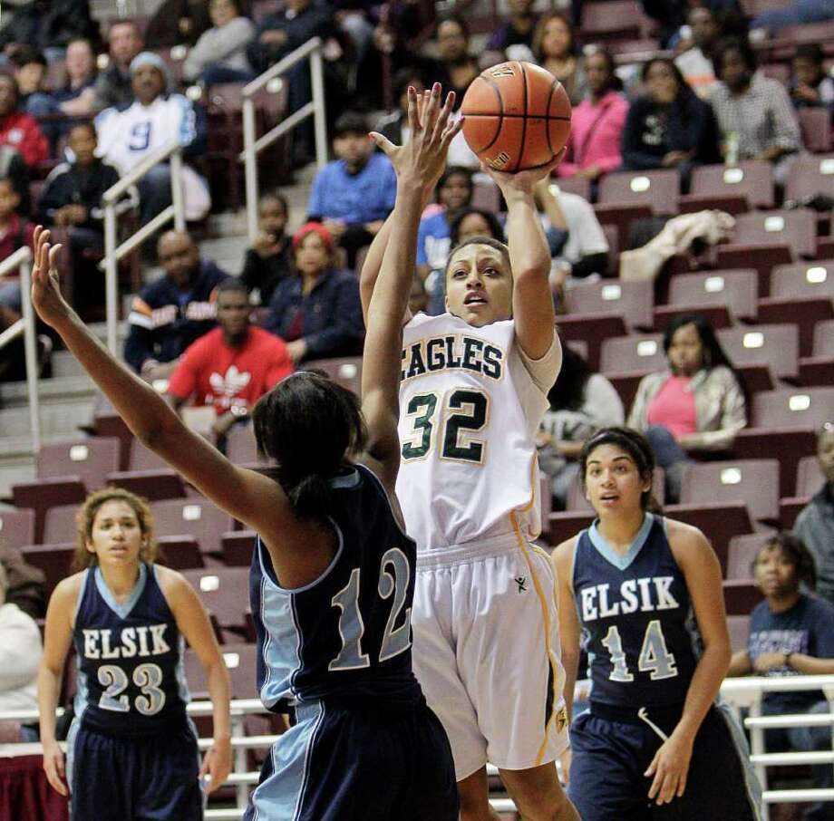 Cy Falls' Loryn Goodwin #32 shoots baseline over Elsik's Akunna Elonu #12 during the Region III 5A girls basketball finals between Cy Falls and Alief Elsik at the M.O. Campbell Center Feb.  25, 2012 in Houston, Tx. Photo: Bob Levey, Houston Chronicle / ©2012 Bob Levey